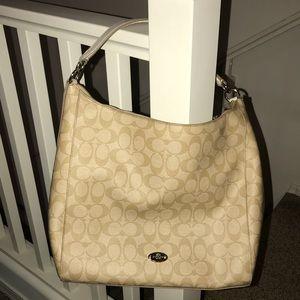 Coach shoulder bag with wallet.